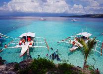 Filipijnen - Sumilon - blauwe zee - bootjes - foto: flickr