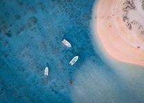 drie boten voor de kust van Mauritius - foto: unsplash