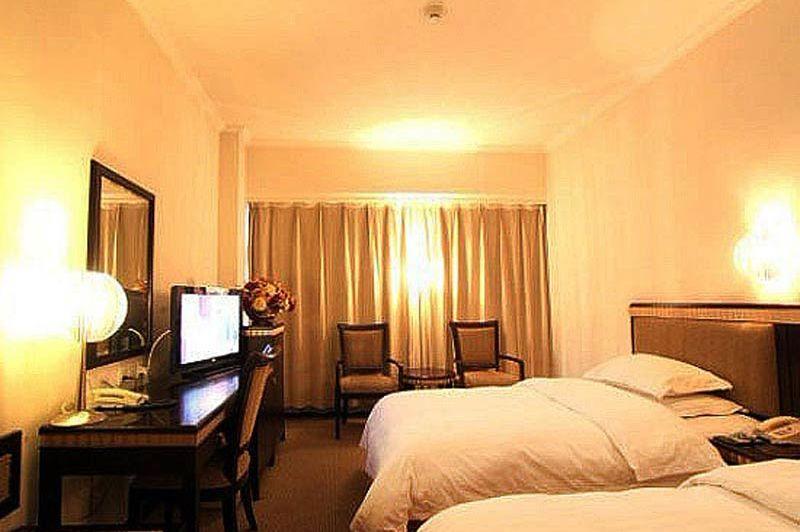 standaardkamer van Luoyang Peony Hotel in Luoyang - Luoyang Peony Hotel - China - foto: Luoyang Peony Hotel