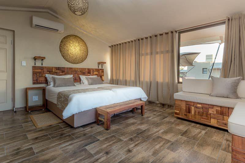 slaapkamer van Sossusvlei Lodge - Sossusvlei Lodge - Namibië - foto: Sossusvlei Lodge