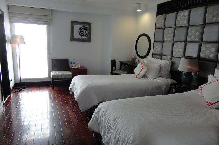 slaapkamer - Maison d'Hanoi Hanova Hotel - Vietnam - foto: Floor Ebbers