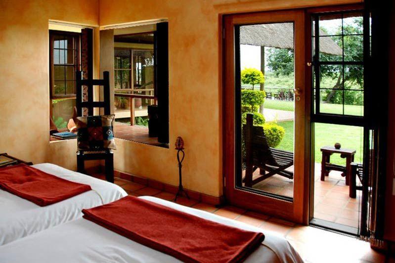 twin kamer met buitenzicht van Buckler's Africa bij Komati Poort - Buckler's Africa - Zuid-Afrika