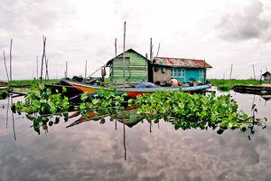 Kalimantan - Borneo - Mahakam rivier - Drijvend huis van Locals - Indonesie - foto: flickr