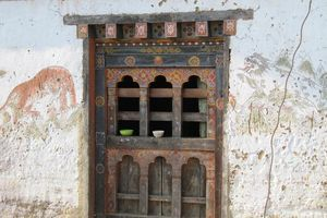 venster van oude farmhouse in Bhutan - Bhutan