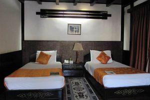 kamer van het Tashi Namgay Resort - Tashi Namgay Resort - Bhutan - foto: Mieke Arendsen
