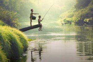 kinderen aan het vissen - Cambodja