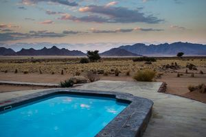 zwembad van Desert Camp - Desert Camp - Namibië