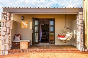 slaapkamer van Kalahari Anib Lodge - Kalahari Anib Lodge - Namibië