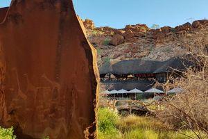 slaapkamer van Twyfelfontein Country Lodge - Twyfelfontein Country Lodge - Namibië