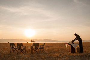 diner bij zonsondergang Maramboi Tented Camp - Maramboi Tented Camp - Tanzania