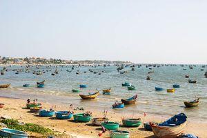 Veel vissersbootjes, Mui Ne