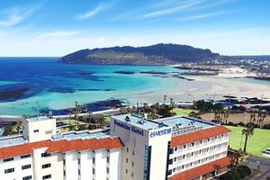 uitzicht op strand vanaf Sunshine Hotel Jeju
